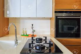 built in stove. Modern Kitchen Interior With Gas Stove, Faucet, Sink And Built-in Electric Oven Built In Stove A