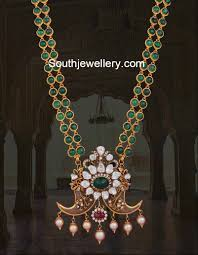 emerald necklace with tiger claw pendant