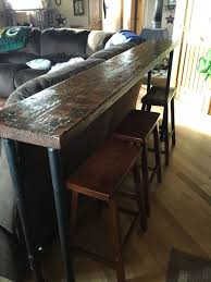 behind the couch bar top 1 inch pipe and 2x12 stained wood top
