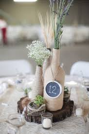 Love the table numbers on mason jar lid idea. 7 awesome DIY wine bottle  centerpiece ideas for your big day!