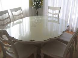 protect your dining table with a custom cut glass top