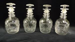 a set of four regency cut glass decanters 4453021