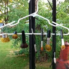diy makeup brush drying rack use tiny rubber bands to attach brushes to a hanger place brushes upside down so they will dry without losing their shape