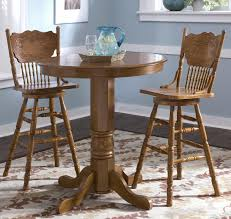three piece dining set:  piece dining sets in antique theme with two dining chair made of wood and round pub table made of wood