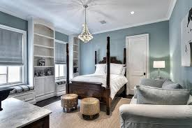 blue guest bedroom with built in window seats