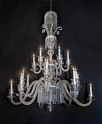 french 19th century 2 tier 18 light baccarat crystal chandelier this chandelier features cut crystal arms cut crystal center marked baccarat on each