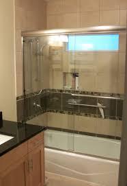 tub shower doors. Bathroom Tub Shower Tile Ideas Dark Wood Textured Stone Floor Tiled White Round American Sink Closet Doors