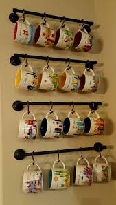 This is a cheaper way to display collected coffee mugs over the coffee bar.