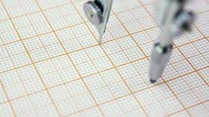 Student Drawing On The Graph Paper Studying Geometry Using Compass D485_4_002