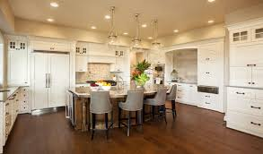 oven in island. Elegant White Kitchen With Large Diner-style Island. The Double Wall Oven Is Centrally In Island S