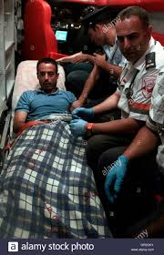an i medic r sits beside nadim injas l inside an an i medic r sits beside nadim injas l inside an ambulance in tel aviv before injas is evacuated to hospital 17 2010
