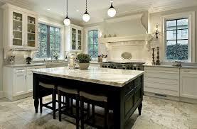 large white kitchen with dark wood island