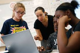 a teacher interacts with students at a in las vegas nevada on june