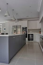 Love the kitchen island in the middle and the color tone - grayish blue  with cone