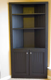 black wood storage cabinet. Tall Black Wood Corner Storage Cabinet With Two Doors And Triple Tiered Open Shelves O