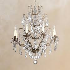 a bronze finish chandelier with legacy crystal glass