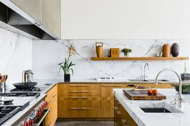 a dallas dream house designed by tod williams billie tsien architects features this stunning kitchen with custom cabinetry and a marble backsplash