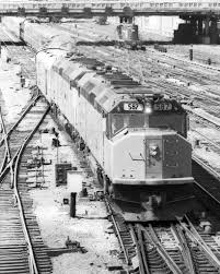 pennsy and n w style pl signals an excellent shot of amtrak 587 heading out of chicago s union station sometime in the mid 70 s notice the domino signals on the bridge in the
