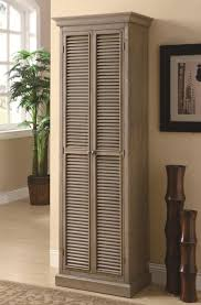 Storage Cabinet Wood Unpolished Shutter Door Tall Storage Cabinet Placed On Cream
