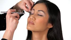 applying eye or lip makeup using an airbrush is a difficult and time consuming task