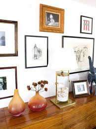 eclectic art gallery wall on wall art gallery frames with how to mat and frame artwork hgtv