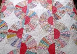 The Literate Quilter: A Gifted Grandmother's Fan Quilt & The tops date to the late Depression Era, but were finished in the 1970s  with a pre-quilted fabric in a preprinted calico flower appliqué pattern. Adamdwight.com