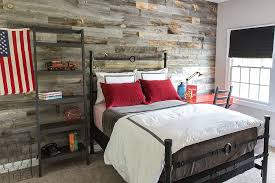 iron bed and reclaimed wood wall bring plenty of texture to the boys bedroom