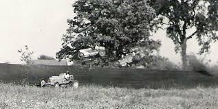 Bob Garringer in the #404 Merkler Special Hisso and Everett Rice going over  the bank at Greenville, Ohio on September 24, 193… | Race track, Race cars,  Vintage cars