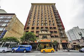 Is the cecil hotel still open for business? What Happened At L A S Cecil Hotel Netflix Is On The Case Los Angeles Times