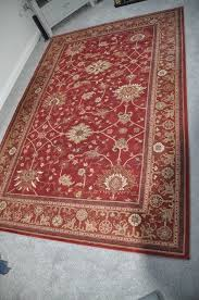 large patterned red wool rug