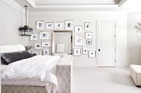 beveled floor mirror with black and white photo wall view full size