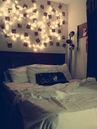 light college apartment rooms. romantic bedroom. used string lights, clothes pins, and pictures.. its an extension of my headboard. | indy apartment pinterest extensions, college light rooms i