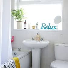 modern white bathroom. modern white bathroom with \u0027relax\u0027 sign