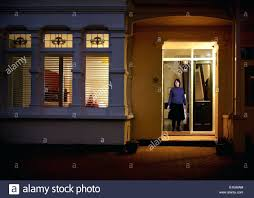 looking out front door. Stock Photo Woman Standing At Front Door Traditional English Victorian House Memories Of Childhood Young Girl Looking Out Window
