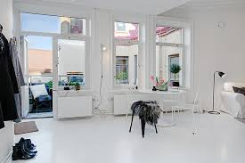 White Floor and White Ceiling near Glass Windows