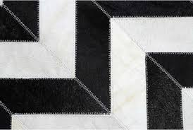 hair on hide detail of black and white chevron patchwork cowhide rug