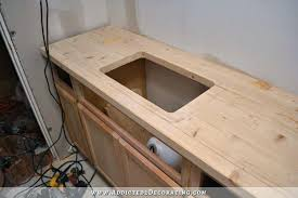 making a wood countertop pine style with hole cut out for sink diy wooden kitchen countertops diy wood plank kitchen countertops