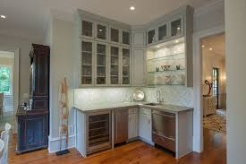 beautiful glass beverage dispenser look atlanta traditional kitchen image ideas with crown molding frame and panel cabinets glass front upper