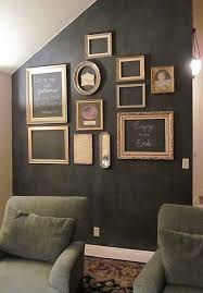 chalkboard accent wall with gold frames but with pink chalk paint accent wall in dining room charcoal black very dramatic