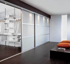 walk closet. Walk In Closet With Forested Glass Doors