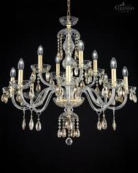 Transparent classic crystal chandelier combined with gold leaf finish.  Crystal trimmings decorated with Swarovski elements crystal.
