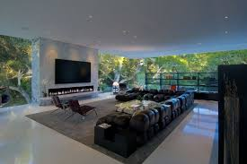 living room ideas with electric fireplace and tv. Fancy Living Room With Large Tv Screen Above Long Electric Fireplace And Using Black Leather L Shaped Sectional For Open Concept Ideas