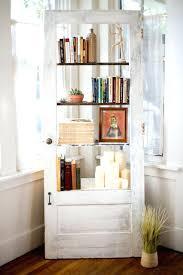 repurposed door vine door into a bookshelf repurposed door coffee table