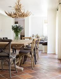 a stone bathroom balances modern and rustic charm perfectly the angled ceiling draws your eyes up towards the stunning antlers