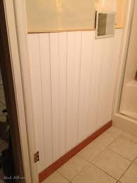 300 bathroom renovation featuring paneling over existing tile