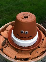 head outdoor ashtray from clay pots painted sprayed with clear weather proof spray