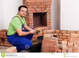 Building A Fireplace Man Building A Brick Stove Or Fireplace Stock Photo Image 39182235
