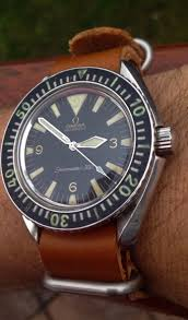 25 best ideas about vintage watches mens watches vintage omega seamaster 300 big triangle diver in stainless steel circa 1960s