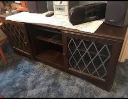 dark wood sideboard with glass doors
