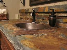 Beautiful Copper sink with an Awesome Slate countertop. I love the various  colors of the slate, especially the gold and reddish browns mixed into the  common ...